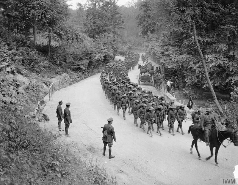 Troops of the 307th Infantry Regiment, 77th Infantry Division on the march in France, June 1918 (Imperial War Museum via Wikipedia)