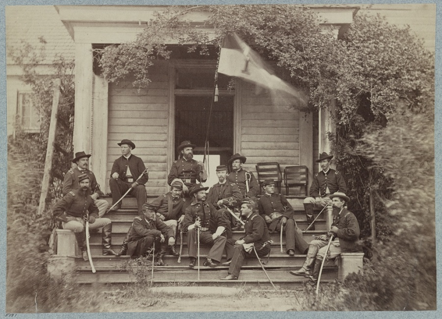 General Torbert and his staff during the American Civil War. John Joseph Coppinger is seated at the front left (Library of Congress)